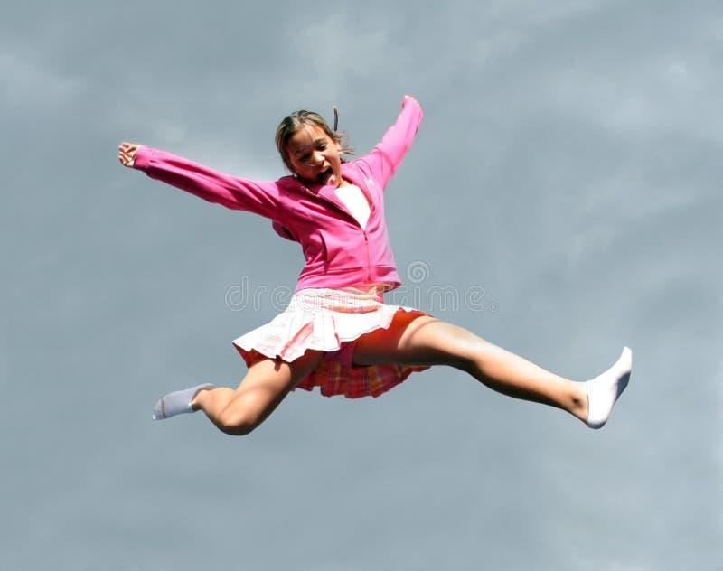 Springend gelukkig meisje royalty-vrije stock afbeelding
