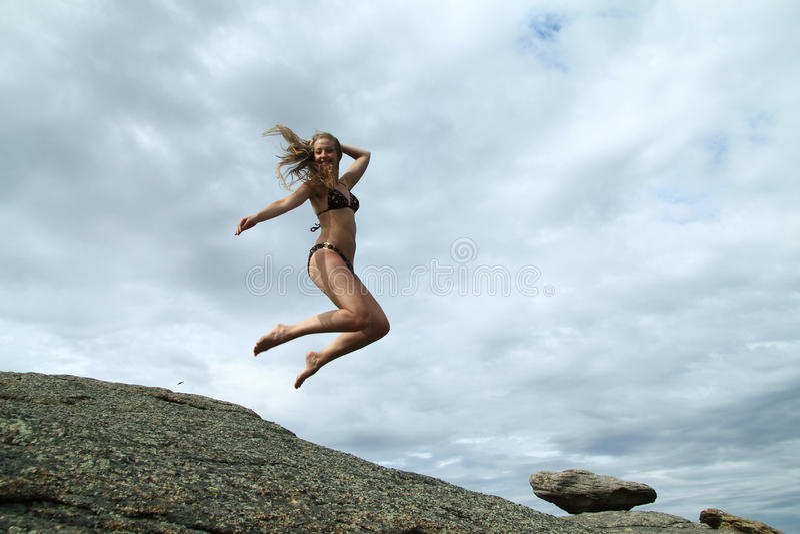 Springend meisje stock afbeelding