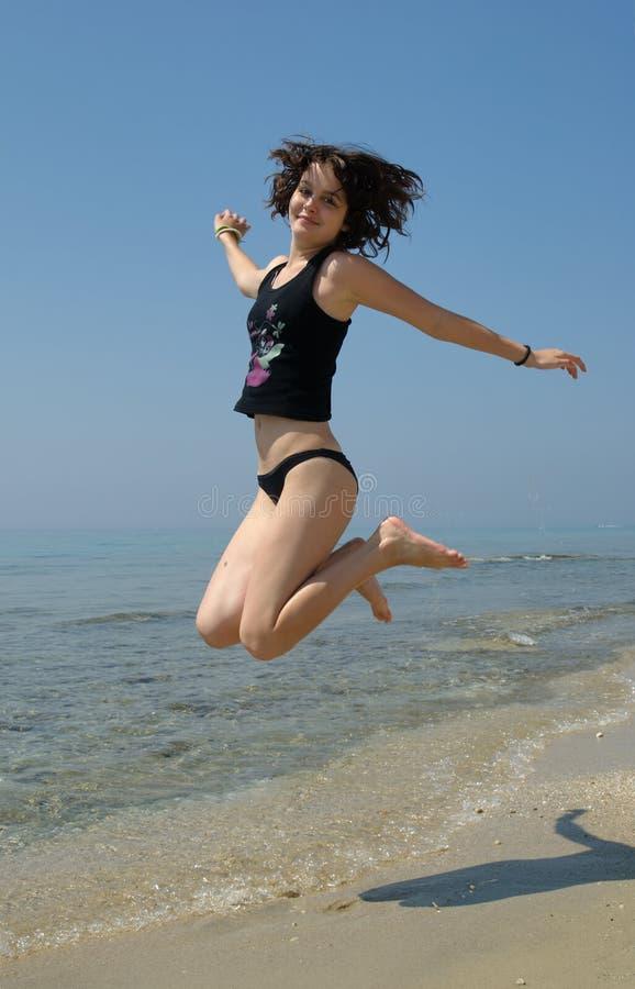 Springend meisje stock fotografie