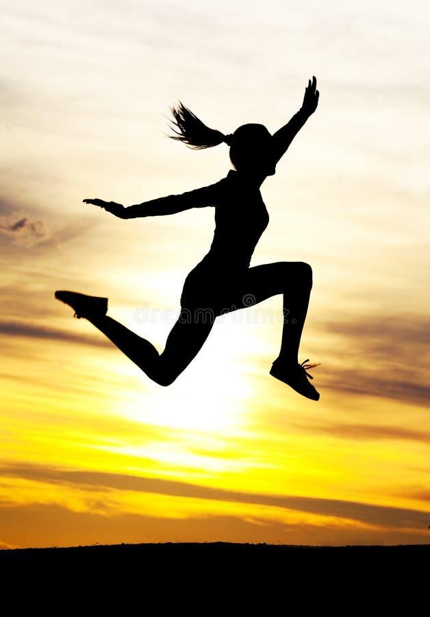 Springende Frau stockfoto