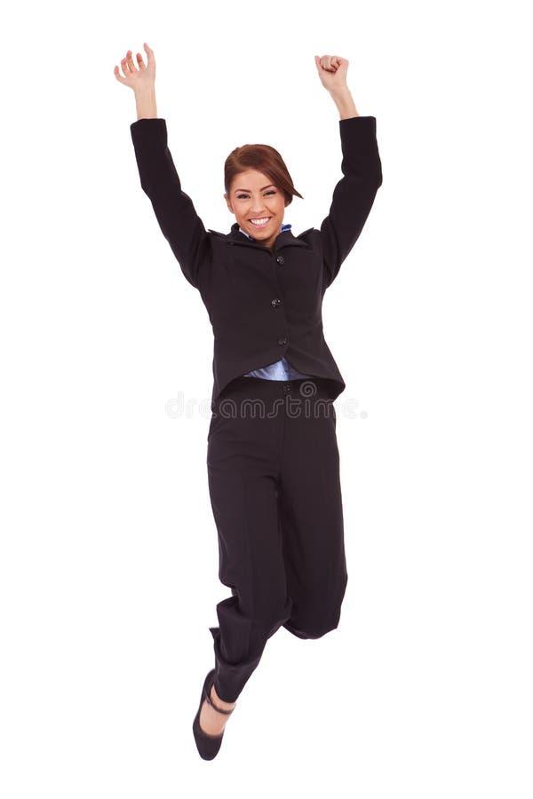 Springende Geschäftsfrau stockbilder