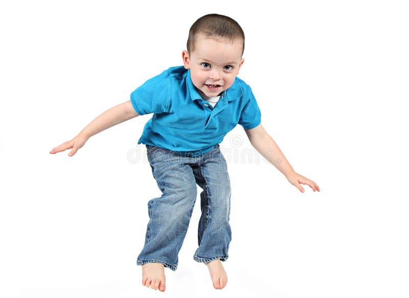 Springende jongen stock foto