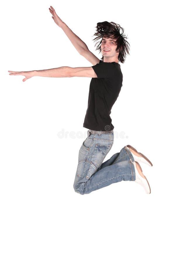 Springende jongen in zwarte 2 stock foto