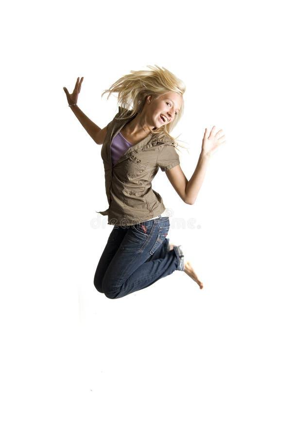 Springende Jugendliche hat Lots Spaß stockbilder