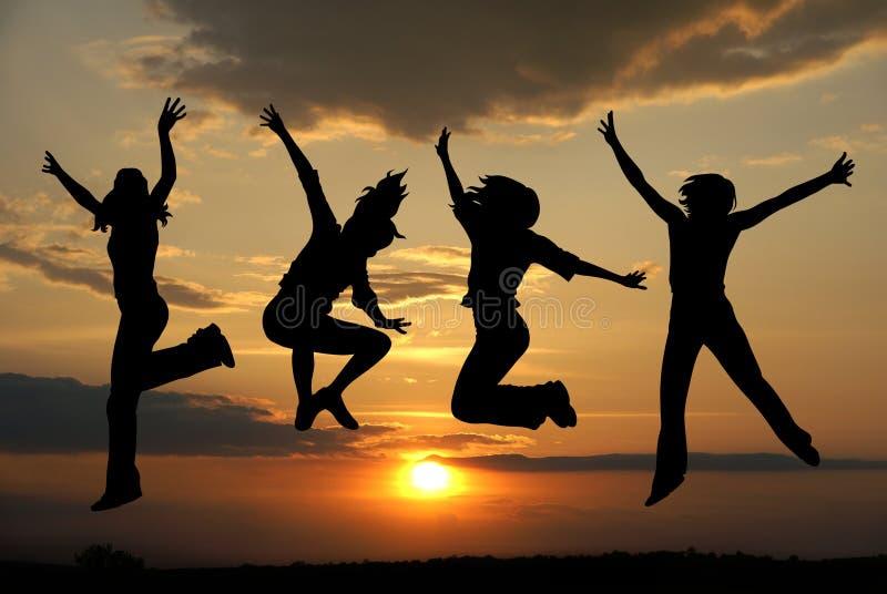 Springende meisjes stock foto