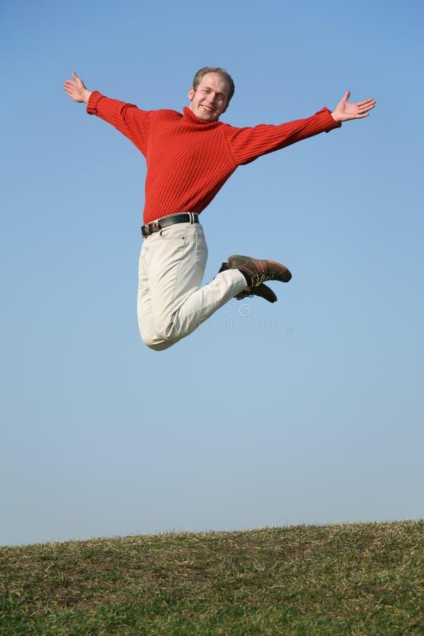Springende mens stock fotografie