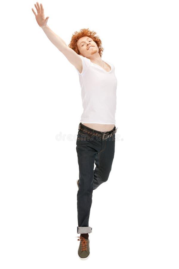 Springende mens in wit overhemd stock foto