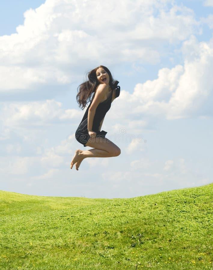 Springende vrouw royalty-vrije stock foto's