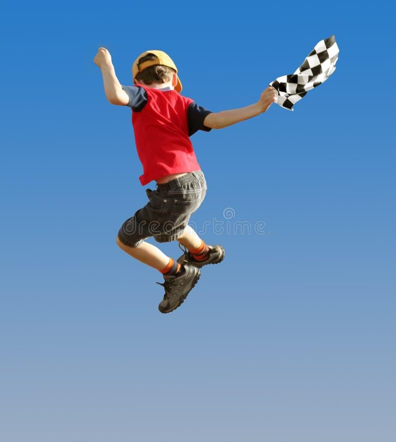 Springender Junge Stockfotografie