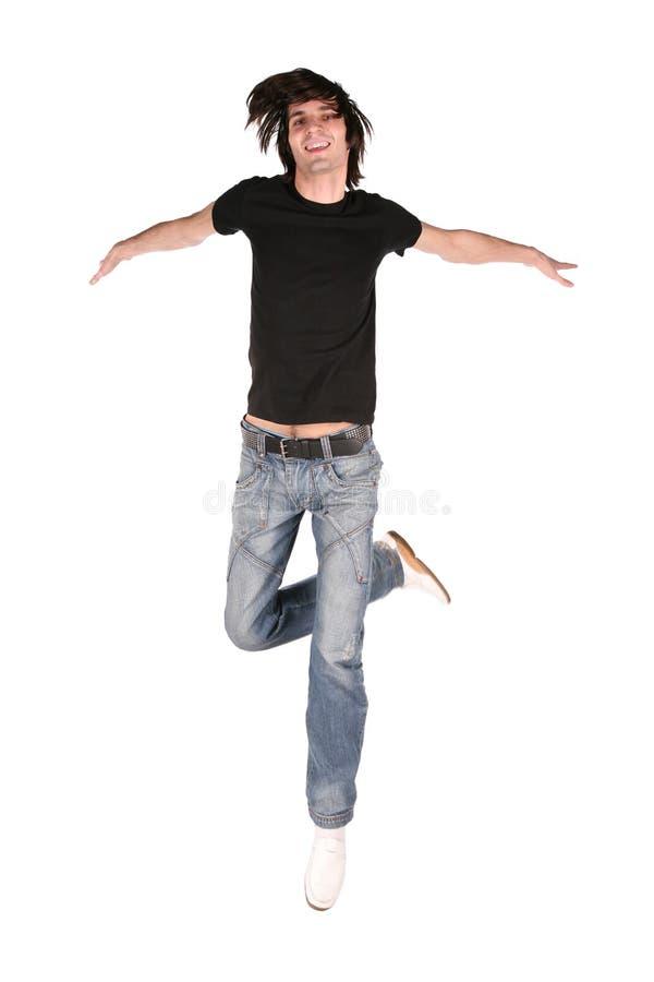 Springender Junge im Schwarzen lizenzfreies stockfoto