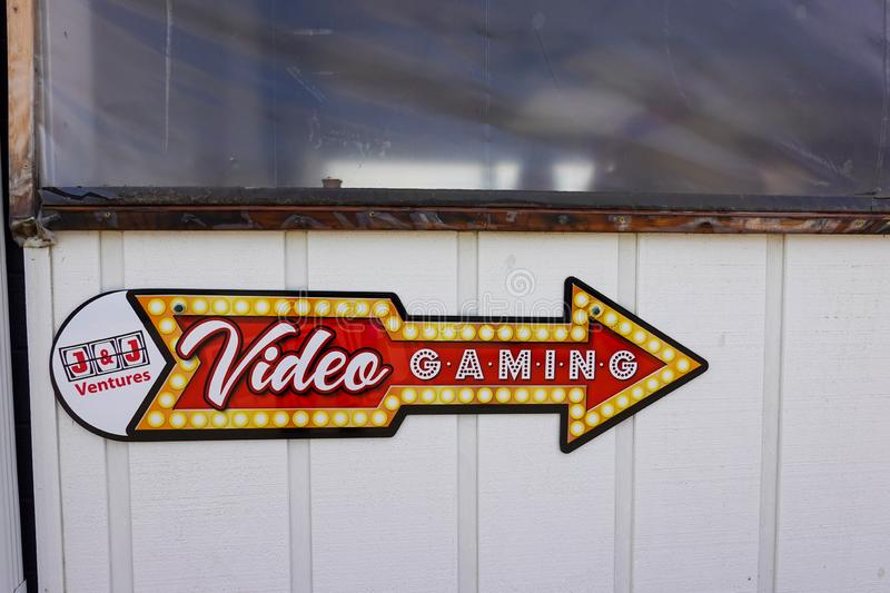 Video gaming sign in front of a restaurant where gambling machines are located royalty free stock photography