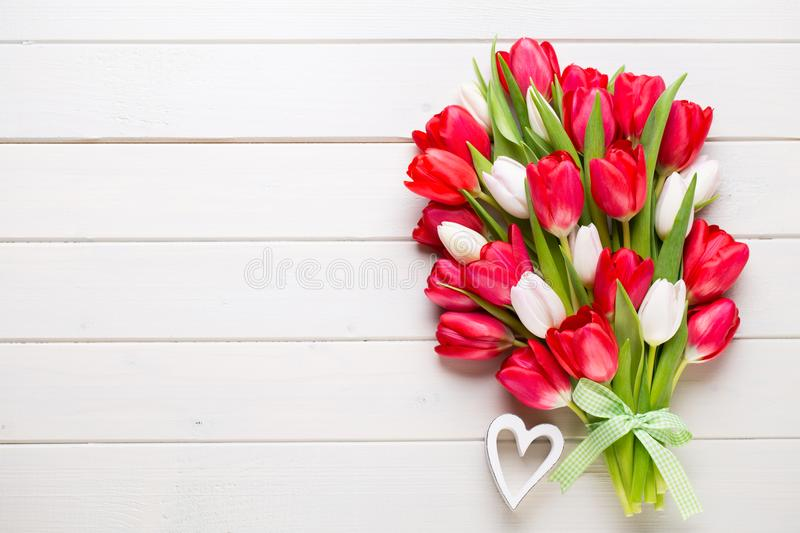 Springt time. Red tulip bouquet on the white wooden background. Springt time. Red tulip bouquet on the white wooden background stock photos