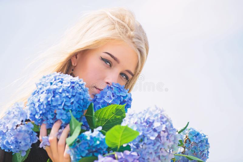 Springtime bloom. Girl tender blonde hold hydrangea flowers bouquet. Natural beauty concept. Skin care and beauty. Treatment. Gentle flower for delicate woman stock photos