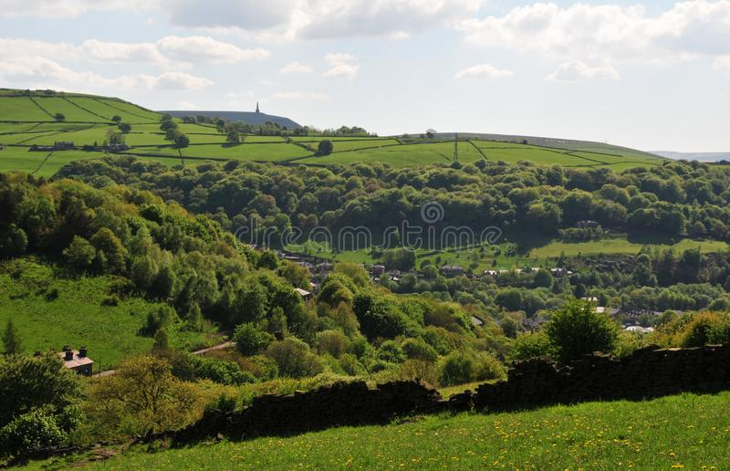 Springtime pennine countryside in calderdale west yorkshire with typical hillside fields, woodland, and houses stock image