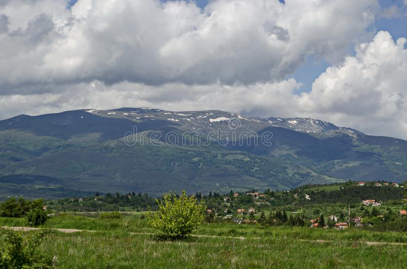 Springtime scene with mountain glade, forest and residential district of bulgarian village Plana at Plana mountain. Near Vitosha mountain,  Bulgaria royalty free stock images