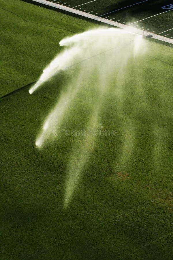 sprinker футбола поля стоковые фотографии rf