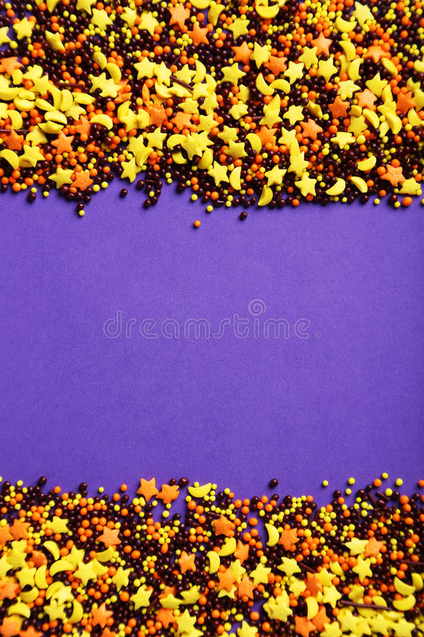 Sprinkle dots and stars. Colorful sprinkle dots and stars on purple background royalty free stock images