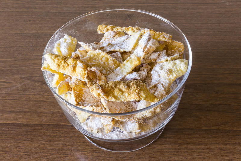 Sprinkle with powdered sugar, fried plate of shortcake dough. Dessert Polish and Lithuanian cuisine - faworki angel wings . stock image