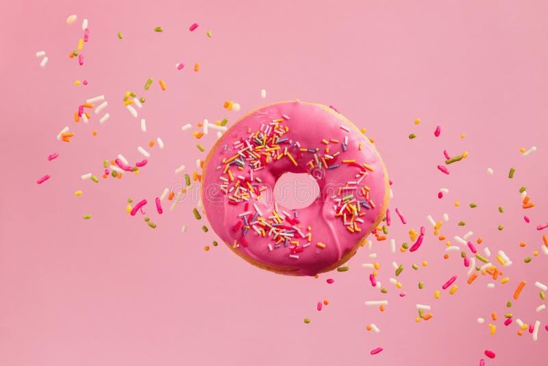 Sprinkled Pink Donut stock images