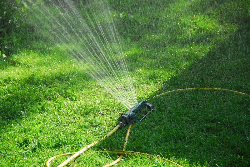 Sprinkler lawn royalty free stock images