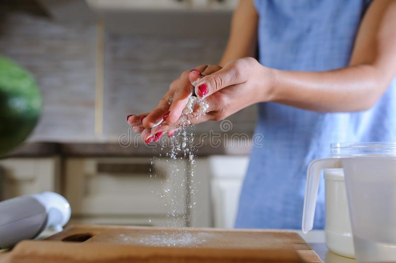 Sprinkling flour, freeze the moment royalty free stock photos