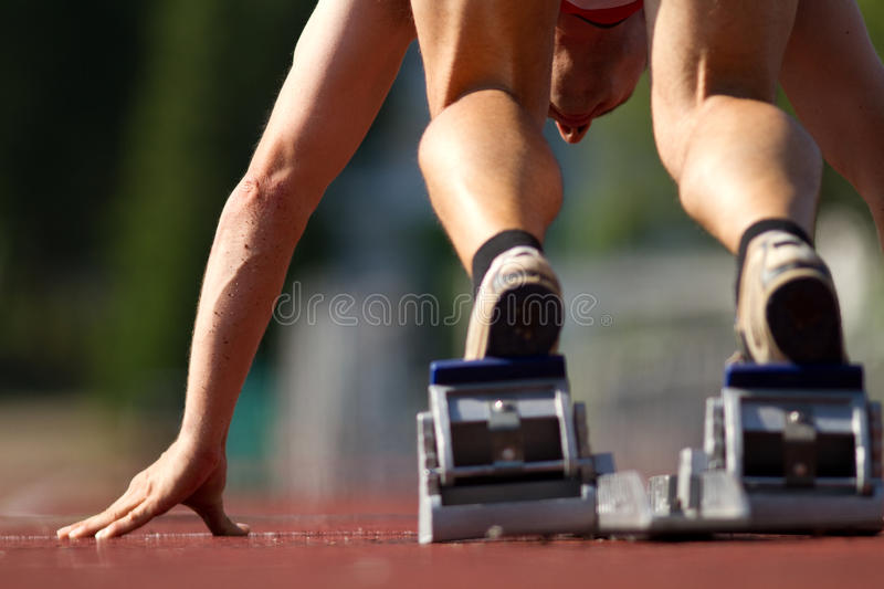 Sprint start. In track and field royalty free stock photo