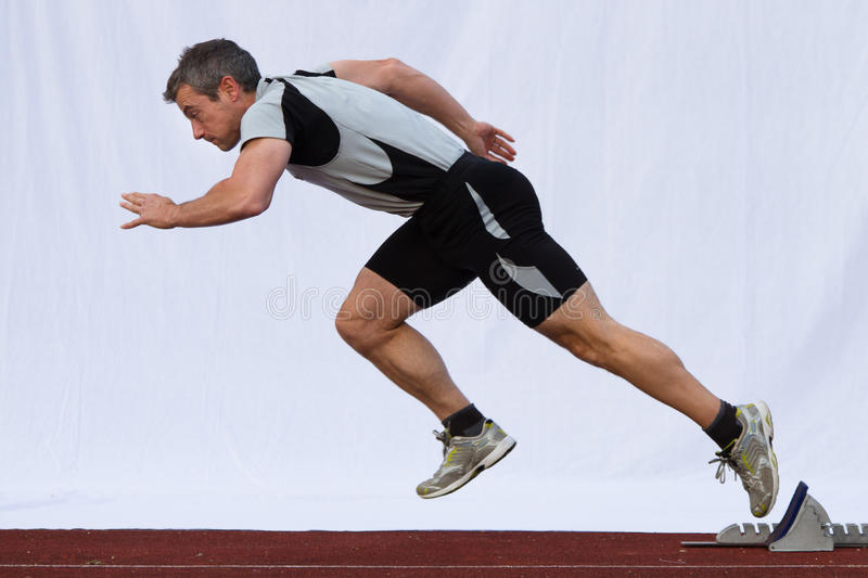 Sprint start. In track and field stock photos