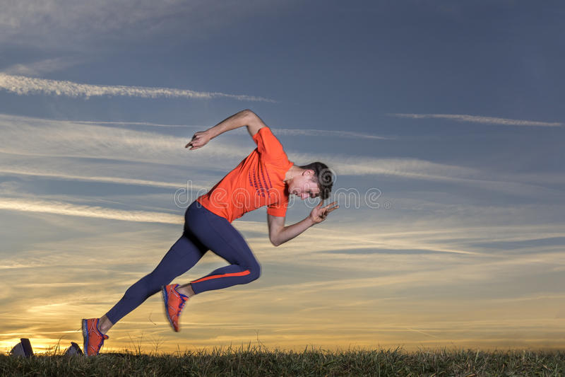 Sprint start in sundown. Sprint start in track and field royalty free stock photos