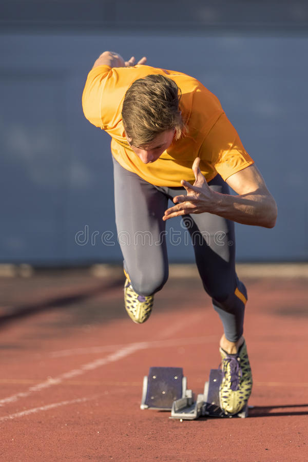 Sprint start. In track and field stock image