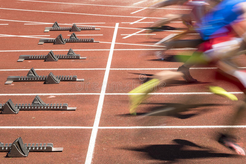 Sprint start in track and field. In blurred motion royalty free stock image