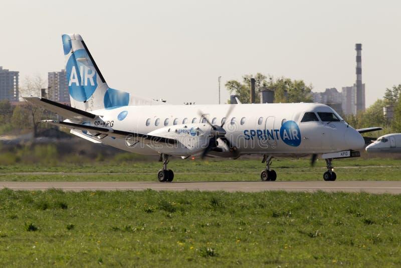 SprintAir Saab 340 aircraft running on the runway royalty free stock image