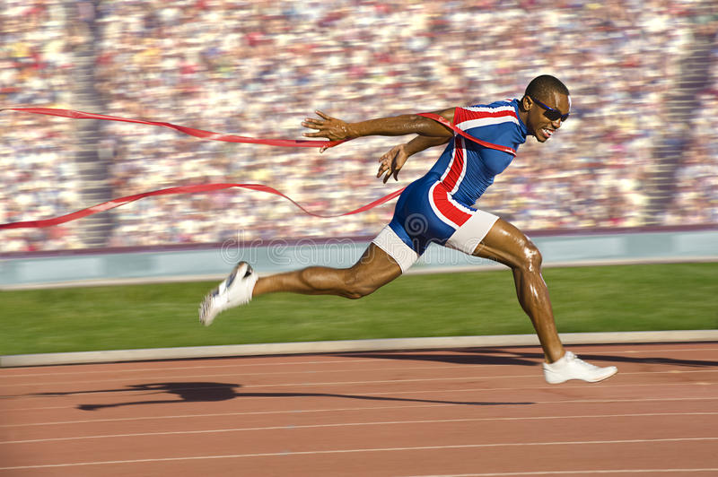 Sprinter Crossing the Finish Line stock photography