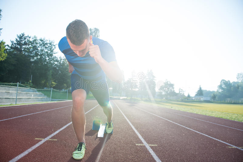 Sprinter leaving starting blocks on the running track. Explosive start. Sprinter leaving starting blocks on the running track. Explosive start royalty free stock photo