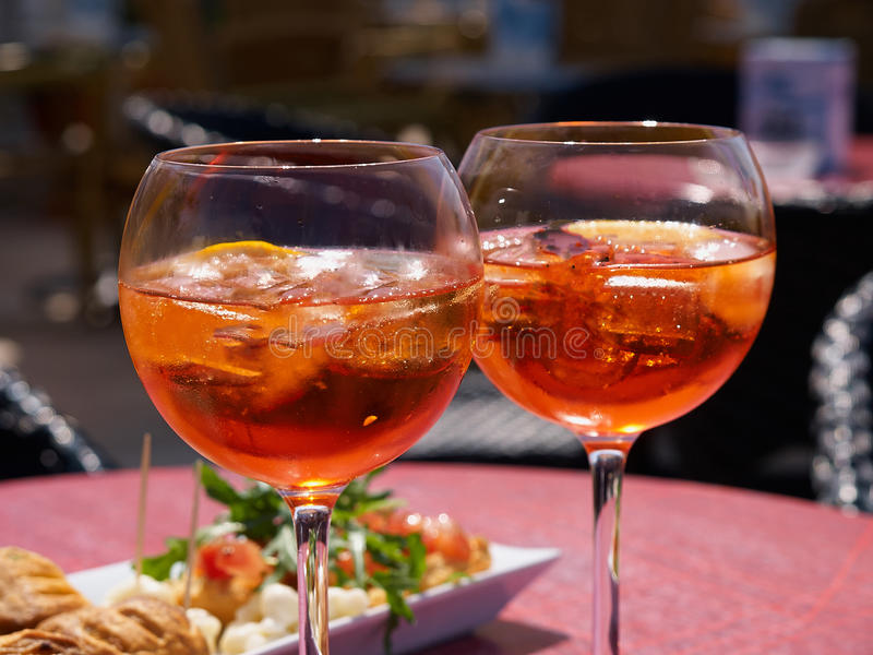 Spritz aperitif in Italy. Spritz aperitif served with Grissini in a restaurant in Italy stock photos