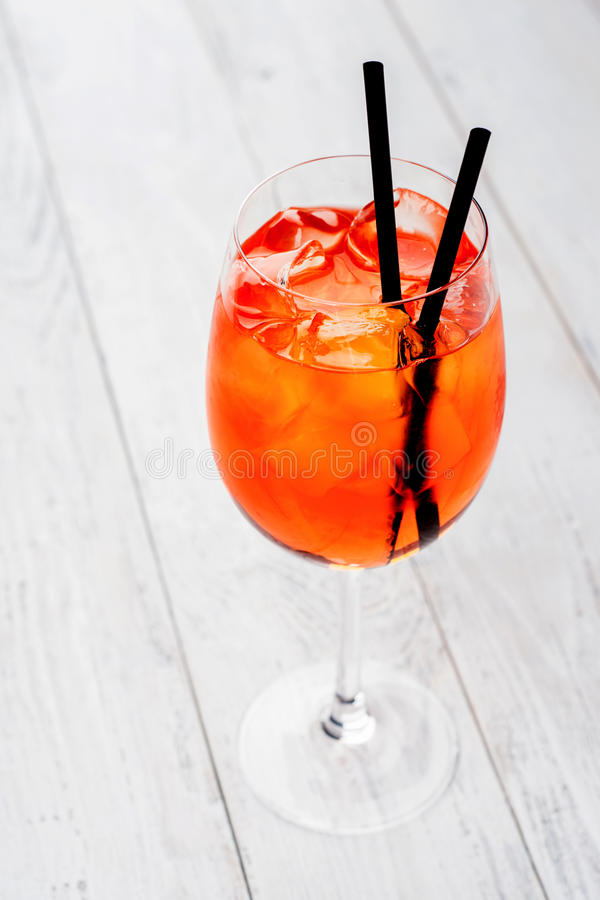 Spritz Aperol cocktail in wine glass on rustic wooden background.  stock photos