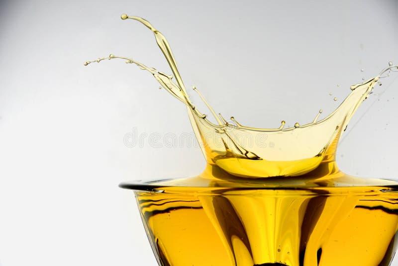 Spritzen des Speiseöls lizenzfreie stockbilder
