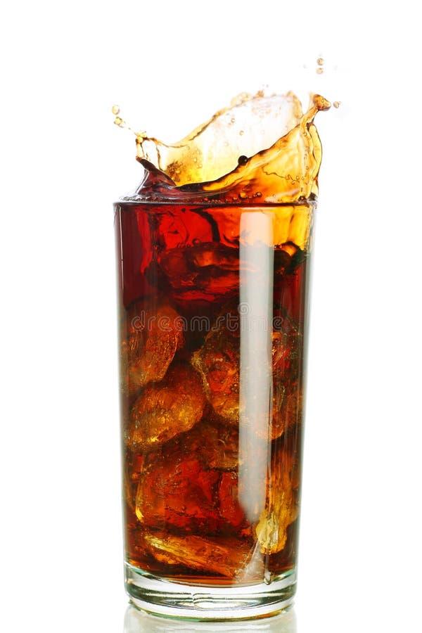 Spritzen in einem Glas lizenzfreie stockfotografie