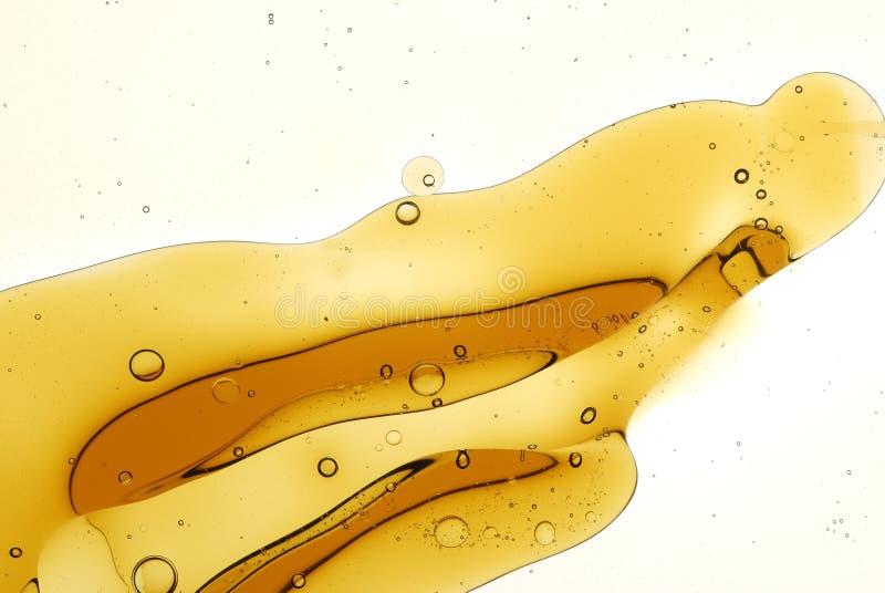 Spritzen von Öl-in-Wasser stockbilder