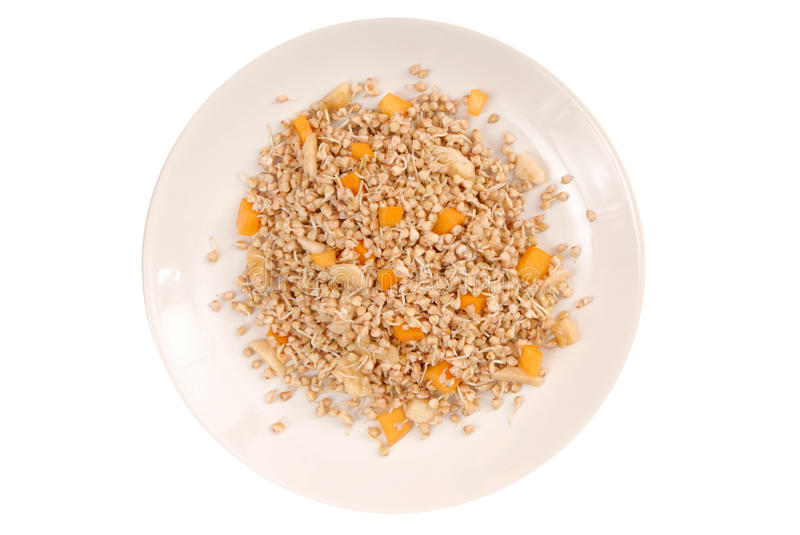 Sprouted kernel of buckwheat and pieces of fruits. Uncooked sprouted kernel of buckwheat and pieces of fruits royalty free stock photography