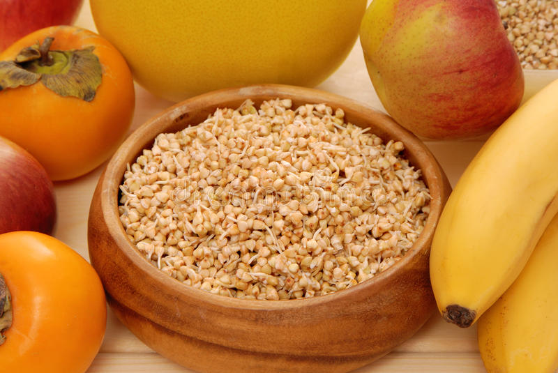 Sprouted kernel and fruits. Sprouted kernel (buckwheat) and fruits royalty free stock photo