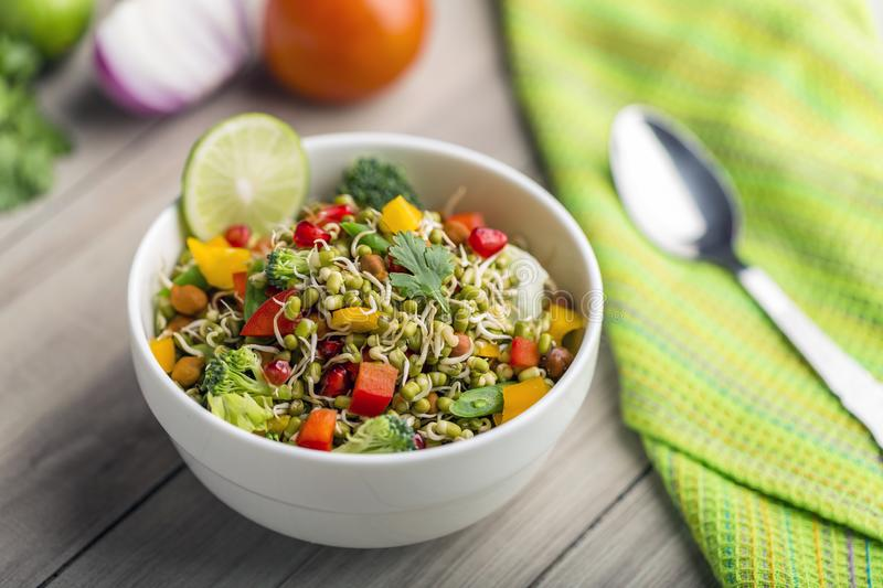Sprouted lentil salad with sliced lemon. Sprouted salad with sliced lemon served in a bowl for good health stock images