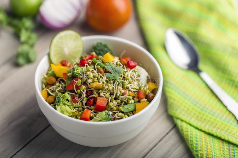 Sprouted lentil salad with sliced lemon. Sprouted salad with sliced lemon served in a bowl for good health stock photo