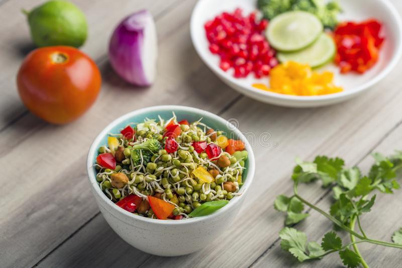 Sprouted lentil salad with sliced lemon. Sprouted salad with sliced lemon served in a bowl for good health stock photos