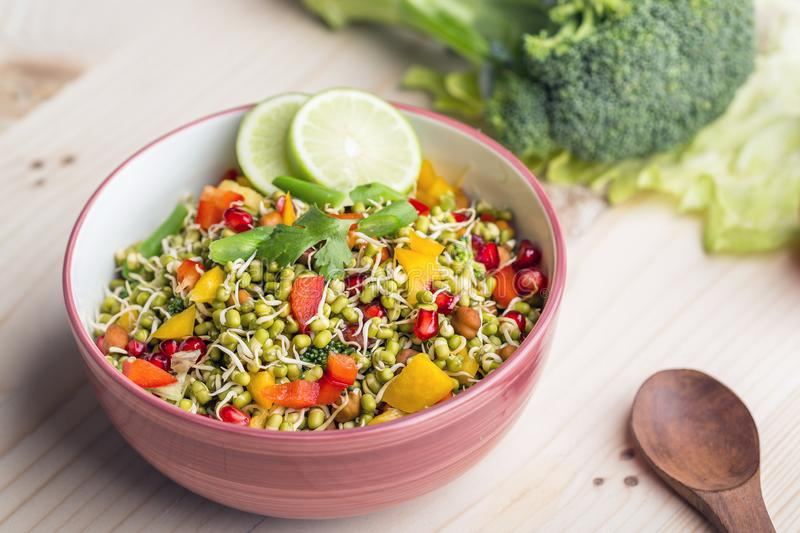 Sprouted lentil salad with sliced lemon. Sprouted salad with sliced lemon served in a bowl for good health royalty free stock photography