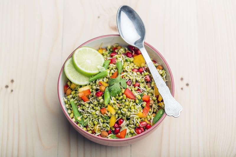Sprouted lentil salad with sliced lemon. Sprouted salad with sliced lemon served in a bowl for good health royalty free stock image