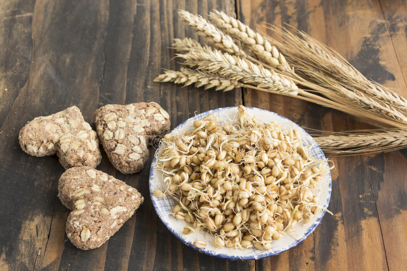 Sprouted Wheat and Whole Wheat Cookies. On Rustic Wooden Background stock images