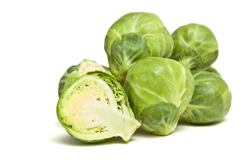 Sprouts. Whole and sliced Brussel Sprout pile from low perspective isolated against white royalty free stock photos