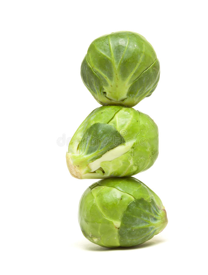 Sprouts Abstract. Abstract stack of Brussel Sprouts from low perspective isolated against white royalty free stock image