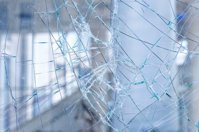 Sprucket exponeringsglas i en shoppafönstercloseup royaltyfria foton