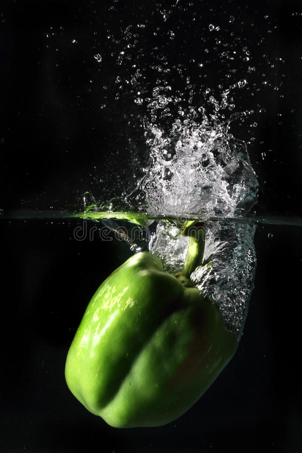 Spruzzata del pepe verde immagini stock